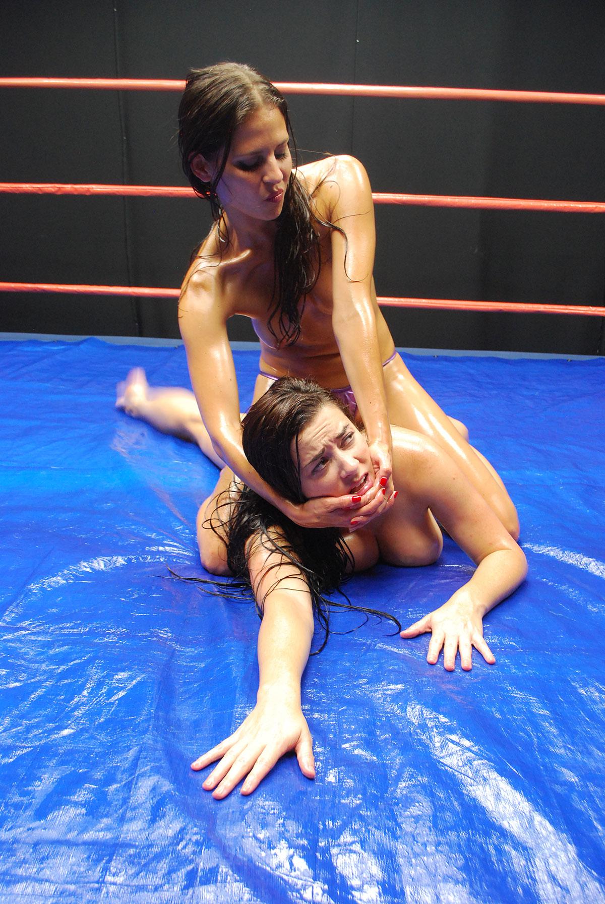 Nude female oil wrestling