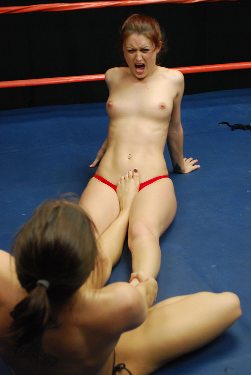Topless woman wrestling