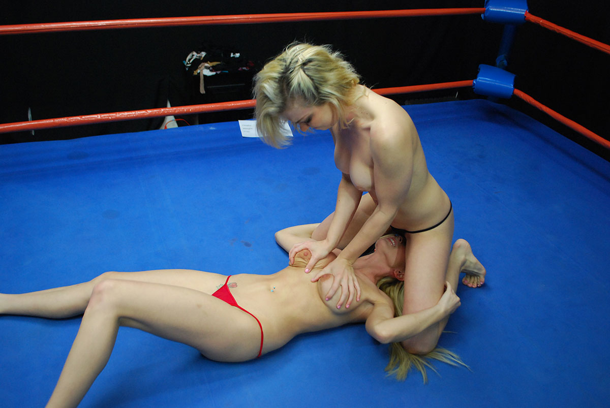 Naked young women wrestling young men