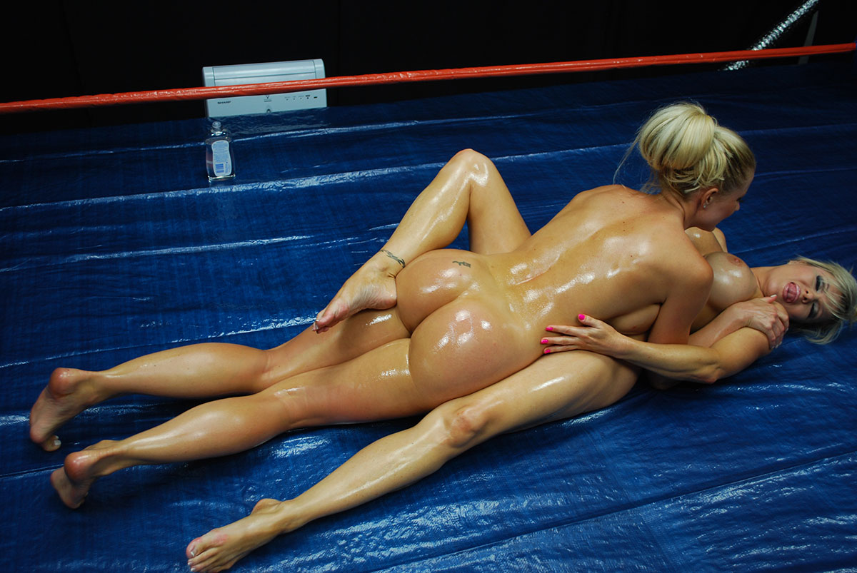 Nude female oil wrestling